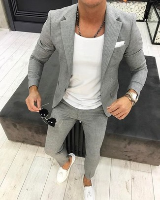 How to wear: grey vertical striped blazer, white crew-neck t-shirt, grey vertical striped dress pants, white leather tassel loafers
