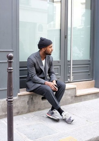 How To Wear Athletic Shoes With Dress Pants For Men: A grey blazer and dress pants are among the crucial elements of a refined closet. Infuse some stylish effortlessness into this look via athletic shoes.