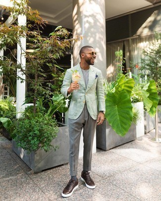Jacket Hot Weather Outfits For Men: This combination of a jacket and grey dress pants is a surefire option when you need to look like a true gent. Dark brown leather low top sneakers will bring a mellow feel to your look.