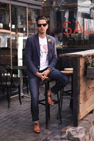 How to Wear a White Print Crew-neck T-shirt For Men: This pairing of a white print crew-neck t-shirt and navy jeans makes for the perfect base for a casually stylish ensemble. Finishing with brown leather oxford shoes is an effortless way to add a bit of zing to your outfit.