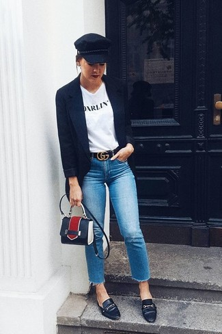 Look amazing without trying too much in a white and black print crew-neck t-shirt and blue jeans. Dress up this look with black leather loafers. When it comes to dressing for awkward transition weather, nothing beats a neat look that transitions easily between seasons.