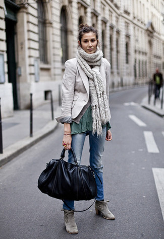 How to wear: grey blazer, dark green crew-neck t-shirt, blue ripped jeans, grey suede ankle boots