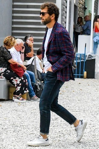 How to Wear White and Black Leather Low Top Sneakers For Men: Seriously stylish yet comfy, this ensemble combines a red and navy plaid blazer and navy jeans. If you want to immediately dress down your ensemble with a pair of shoes, add white and black leather low top sneakers to the mix.