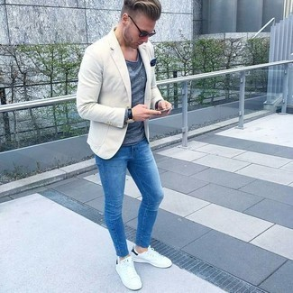 How to Wear a Beige Blazer For Men: This pairing of a beige blazer and blue jeans exudes class and sophistication. If you need to immediately play down this outfit with one piece, complete your getup with a pair of white leather low top sneakers.