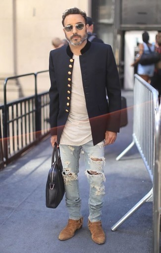 How to Wear a Beige Crew-neck T-shirt For Men: This pairing of a beige crew-neck t-shirt and light blue ripped jeans is the ultimate laid-back outfit for today's gent. A pair of tan suede chelsea boots will put a different spin on your outfit.