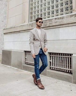 Grey Blazer with Blue Jeans Outfits For Men: This smart casual pairing of a grey blazer and blue jeans is extremely easy to throw together without a second thought, helping you look on-trend and ready for anything without spending too much time rummaging through your wardrobe. A pair of brown leather casual boots looks right at home teamed with this outfit.