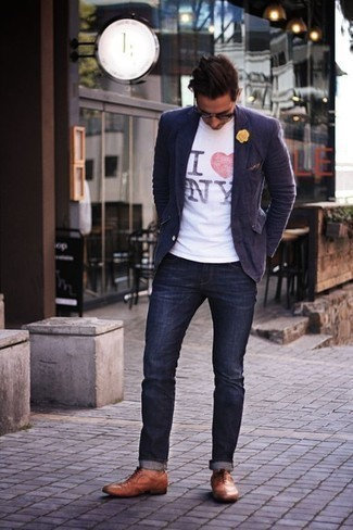 How to Wear a White Print Crew-neck T-shirt For Men: Pair a white print crew-neck t-shirt with navy jeans to pull together an extra dapper and relaxed ensemble. Add a pair of tobacco leather brogues to this outfit to effortlessly up the fashion factor of your ensemble.
