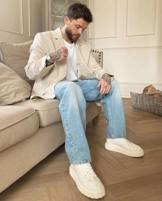 Beige Blazer Outfits For Men: Rock a beige blazer with light blue jeans if you're going for a crisp, dapper getup. If you want to effortlessly play down your ensemble with a pair of shoes, add a pair of beige leather low top sneakers.