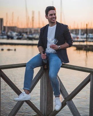 Grey Blazer with Blue Jeans Casual Outfits For Men: Consider teaming a grey blazer with blue jeans to achieve a neat and sophisticated getup. Finish with a pair of white canvas low top sneakers to upgrade this ensemble.