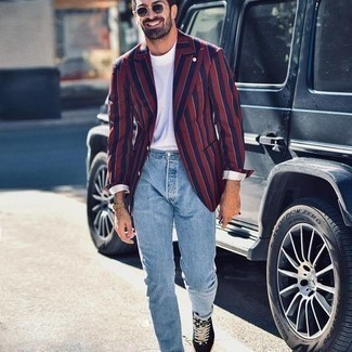 500+ Summer Outfits For Men: This pairing of a navy and red vertical striped blazer and light blue jeans is undeniable proof that a safe casual ensemble doesn't have to be boring. Does this ensemble feel too classic? Let a pair of black and white canvas low top sneakers shake things up. You totally can remain fresh and pulled-together under the unbearable heat. The proof is right here