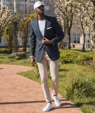 White Leather Low Top Sneakers Outfits For Men: A navy blazer and beige jeans are the perfect way to introduce some sophistication into your off-duty lineup. Ramp up the appeal of this ensemble by sporting a pair of white leather low top sneakers.