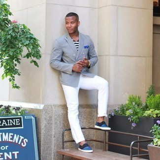 Light Blue Blazer Outfits For Men: A light blue blazer and white jeans will add extra style to your daily fashion mix. Finishing off with a pair of blue leather slip-on sneakers is the simplest way to infuse a dash of stylish effortlessness into your outfit.
