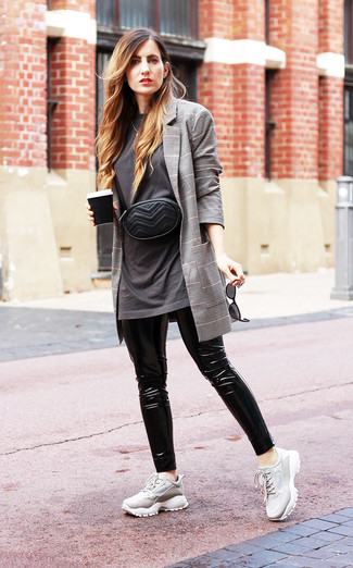 How to wear: grey plaid blazer, charcoal crew-neck t-shirt, black leather leggings, grey athletic shoes