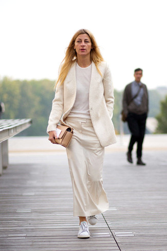 Consider teaming a nude wool blazer jacket with a nude midi skirt to showcase you've got serious styling prowess. White low top sneakers will contrast beautifully against the rest of the look. If you're looking for a neat getup that transitions easily into spring, this one fits the task well.