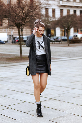 How to wear: charcoal blazer, grey print crew-neck t-shirt, black leather mini skirt, black leather lace-up flat boots