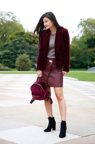 How to wear: burgundy velvet blazer, grey crew-neck t-shirt, red leather mini skirt, black suede lace-up ankle boots