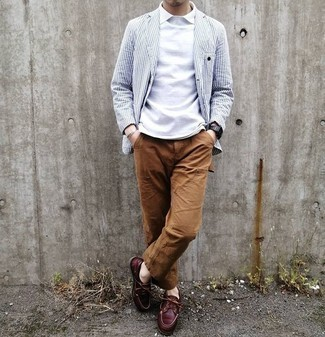 Brown Chinos Outfits: Consider pairing a white and navy vertical striped blazer with brown chinos if you're going for a proper, seriously stylish look. Burgundy leather boat shoes will add a laid-back feel to an otherwise mostly classic look.