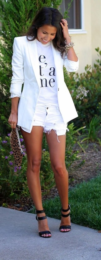 Go for a white blazer and white destroyed denim shorts to achieve a chic look. Polish off the ensemble with black leather heeled sandals.