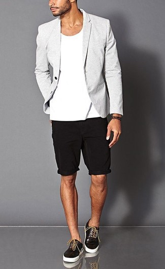 Stand out among other stylish civilians in a grey sportcoat and shorts. A pair of black leather low top sneakers brings the dressed-down touch to the ensemble.