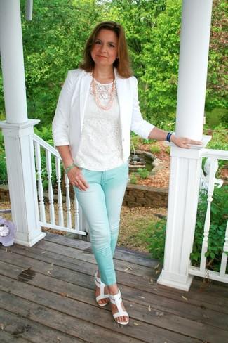 How to wear: white blazer, white lace crew-neck t-shirt, aquamarine skinny jeans, white leather gladiator sandals