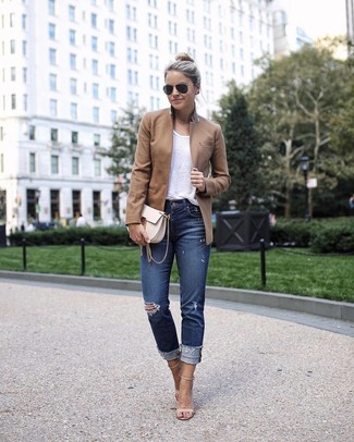 Brown Blazer Outfits For Women: A brown blazer and navy ripped skinny jeans are wonderful must-haves that will integrate well within your daily styling collection. Here's how to give this outfit a touch of sophistication: beige leather heeled sandals.