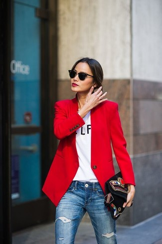 Master the effortlessly chic look in a red jacket and a black suede clutch. This combination is the definition of perfect for when leaves are falling down and temps are dropping.