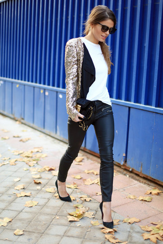 Let everyone know that you know a thing or two about style in a gold sequin blazer jacket and black leather skinny pants. Round off this look with black suede pumps.