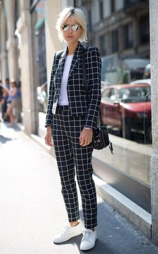 If you're a fan of classic pairings, then you'll like this combination of a black and white blazer jacket and black and white check slim pants. White low top sneakers will add a new dimension to an otherwise classic look.