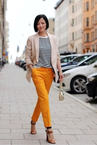 How to wear: beige blazer, white and black horizontal striped crew-neck t-shirt, orange tapered pants, brown leather heeled sandals