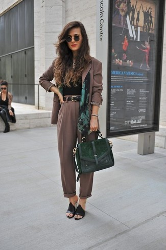 Brown Blazer Outfits For Women: For something more on the relaxed side, consider teaming a brown blazer with brown tapered pants. Not sure how to finish off? Add black suede mules to the equation to turn up the chic factor.
