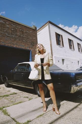 How to wear: beige blazer, black cropped top, black bike shorts, gold leather heeled sandals