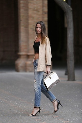 Wear a black lace cropped top with blue destroyed jeans for a casual level of dress. Add a glam twist to your ensemble with black leather heeled sandals. As you know, the trick to getting through the hottest time of year is wearing cool outfits like this one.