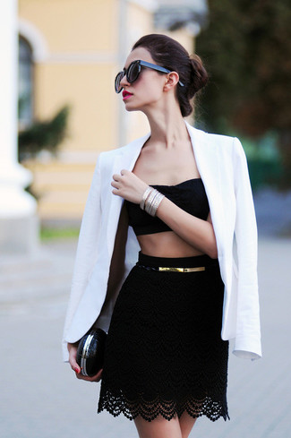 Rock a black lace cropped top with a black lace mini skirt to effortlessly deal with whatever this day throws at you.