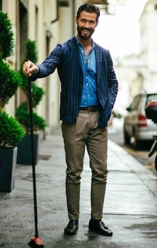 How to Wear a Navy Vertical Striped Blazer For Men: So as you can see, looking casually sleek doesn't take that much time. Just choose a navy vertical striped blazer and brown chinos and be sure you'll look incredibly stylish. Dial up this look by rounding off with a pair of black leather tassel loafers.