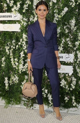 Miroslava Duma wearing Navy Vertical Striped Blazer, Navy Vertical Striped Dress Pants, Beige Suede Pumps, Beige Leather Clutch