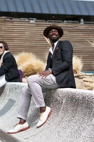 Brown Polka Dot Pocket Square Outfits: One of the best ways for a man to style out a black blazer is to marry it with a brown polka dot pocket square for a casual getup. Put a different spin on this getup by finishing off with white leather derby shoes.