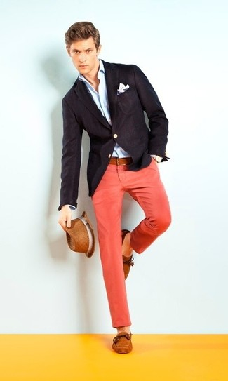 Pair a black blazer jacket with red chino pants if you're going for a neat, stylish look. Cognac suede boat shoes will add some edge to an otherwise classic look.