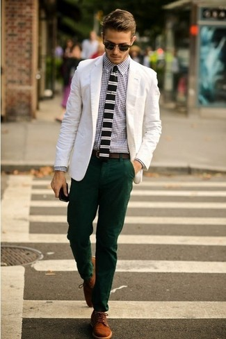 Stand out among other stylish civilians in a white cotton blazer and dark green chino pants. A pair of brown suede derby shoes will bring a strong and masculine feel to any ensemble.