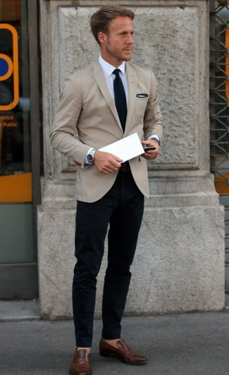 Try teaming a nude sportcoat with navy chinos to create a smart casual look. Brown leather loafers are a great choice to complete the look.