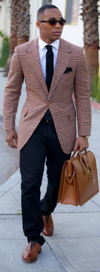 A smart casual combination of a tan check suit jacket and navy blue casual pants can maintain its relevance in many different circumstances. Tap into some David Gandy dapperness and complete your look with brown leather brogues.