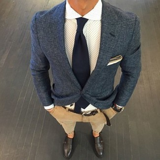 Make a navy blue blazer jacket and tan chinos your outfit choice if you're going for a neat, stylish look. For footwear go down the classic route with dark brown leather double monks.