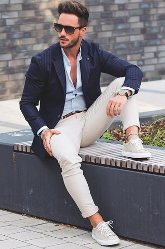Perfect the smart casual look in a dark blue vertical striped blazer and cream chinos. If you don't want to go all out formal, rock a pair of beige low top sneakers.