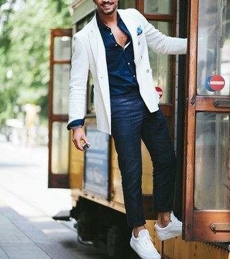 Rock a white jacket with navy chino pants to look classy but not particularly formal. A good pair of white sneakers are sure to leave the kind of impression you want to give. We love that this combo is ideal when summer settles in.
