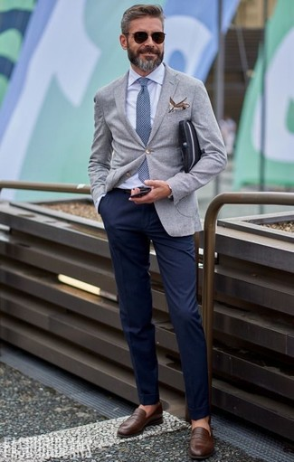For a smart casual look, choose a grey blazer and navy chinos — these items the place of work nicely together. When it comes to shoes, this look is finished off wonderfully with brown leather loafers.