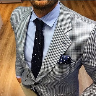 A white and black houndstooth blazer and a navy polka dot pocket square work together beautifully. This combination is our idea of perfection for hot afternoons.