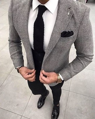 Perfect the smart casual look in a grey wool suit jacket and black chinos. Why not introduce oxford shoes to the mix for an added touch of style?