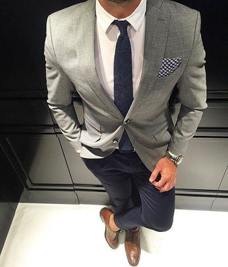 Pair a grey sport coat with black chinos for your nine-to-five. Brown leather brogues look amazing here. This outfit is likely to become your summertime favorite.