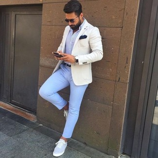 How to wear: beige blazer, light blue dress shirt, light blue chinos, grey canvas low top sneakers