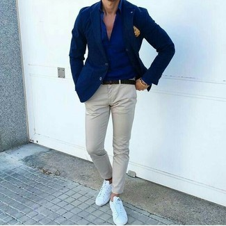 Such garments as a navy blazer and a yellow pocket square are the great way to infuse extra sophistication into your daily repertoire. For footwear go down the casual route with white leather low top sneakers. This combination is ideal when it's hot outside.
