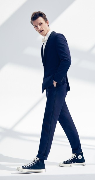 How to Wear Navy Canvas High Top Sneakers For Men: Choose a navy blazer and navy chinos and you'll create a sleek and refined ensemble. To inject a laid-back vibe into this getup, add navy canvas high top sneakers to the mix.
